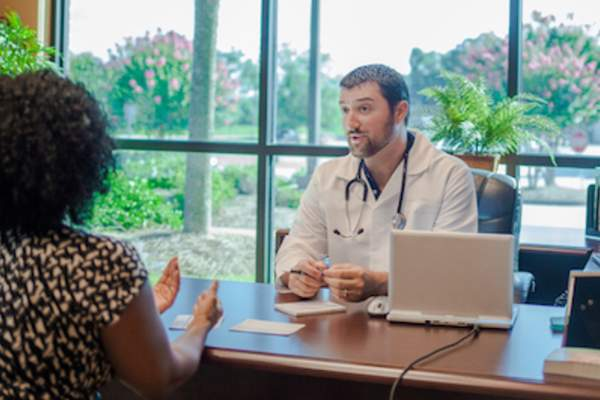 Patient talking with OBGYN