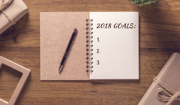 2018 goals notebook open on table.