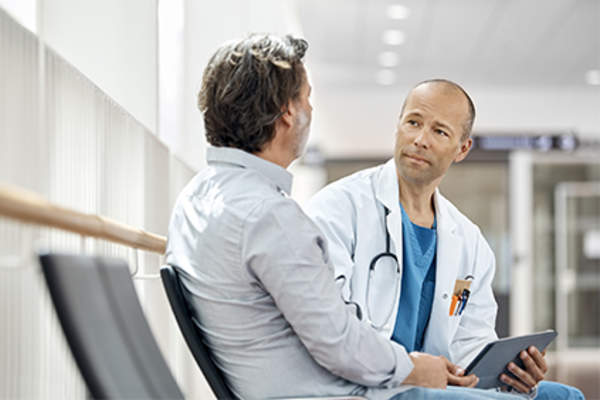 Man talking to his doctor.