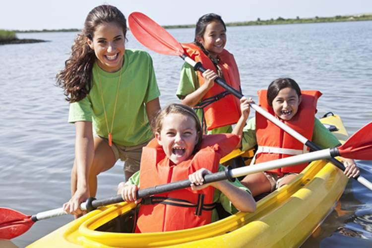 girls in kayaks at summer camp image