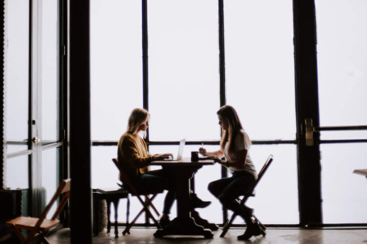 two women in cafe talking