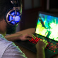 Thumb-young-gamer-playing-video-game-wearing-headphones