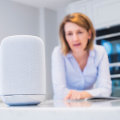 Thumb-Woman-In-Kitchen-Calling-Digital-Assistant