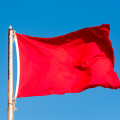 Thumb-red-flag-against-blue-sky