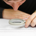 Thumb-man-examining-a-document-with-a-magnifying-glass