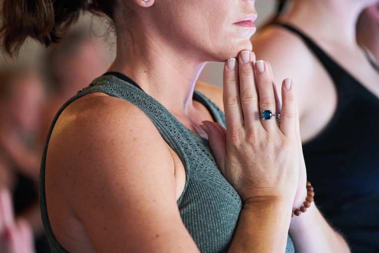 woman-yoga-prayer-hands-class.jpg