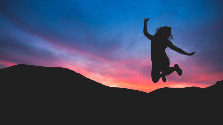sunset-jumping-for-joy-woman.jpg