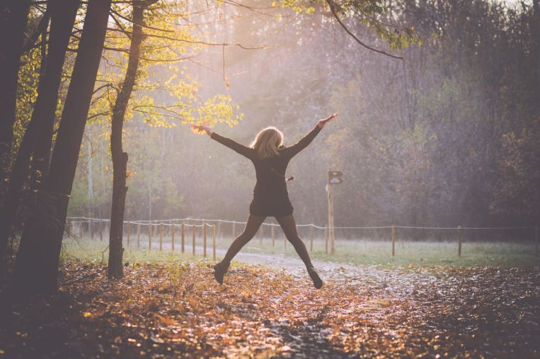 autumn-leaves-jumping-joy-woman.jpg