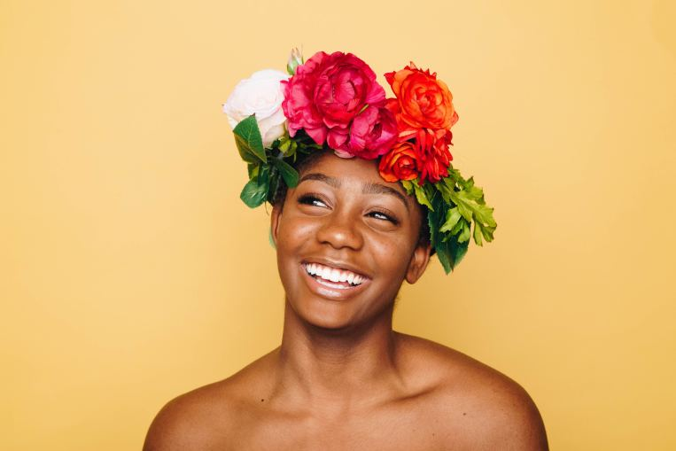 woman-flower-crown-smiling-joy.jpg