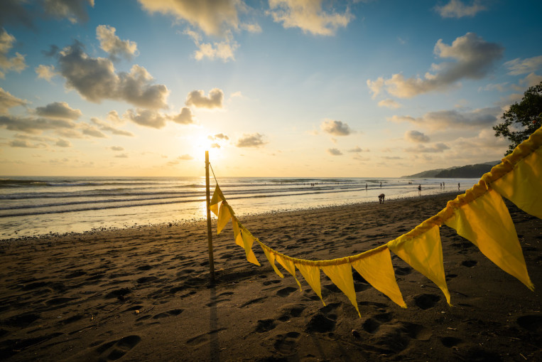 yellow-flags-beach-sunset-clouds.jpg
