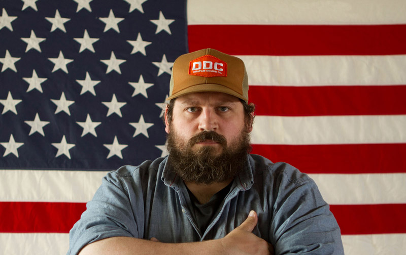 Aaron Draplin in front of an American Flag