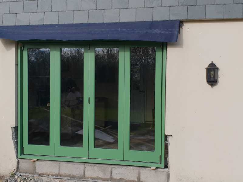 Hardwood 4 leaf bi-folding doors