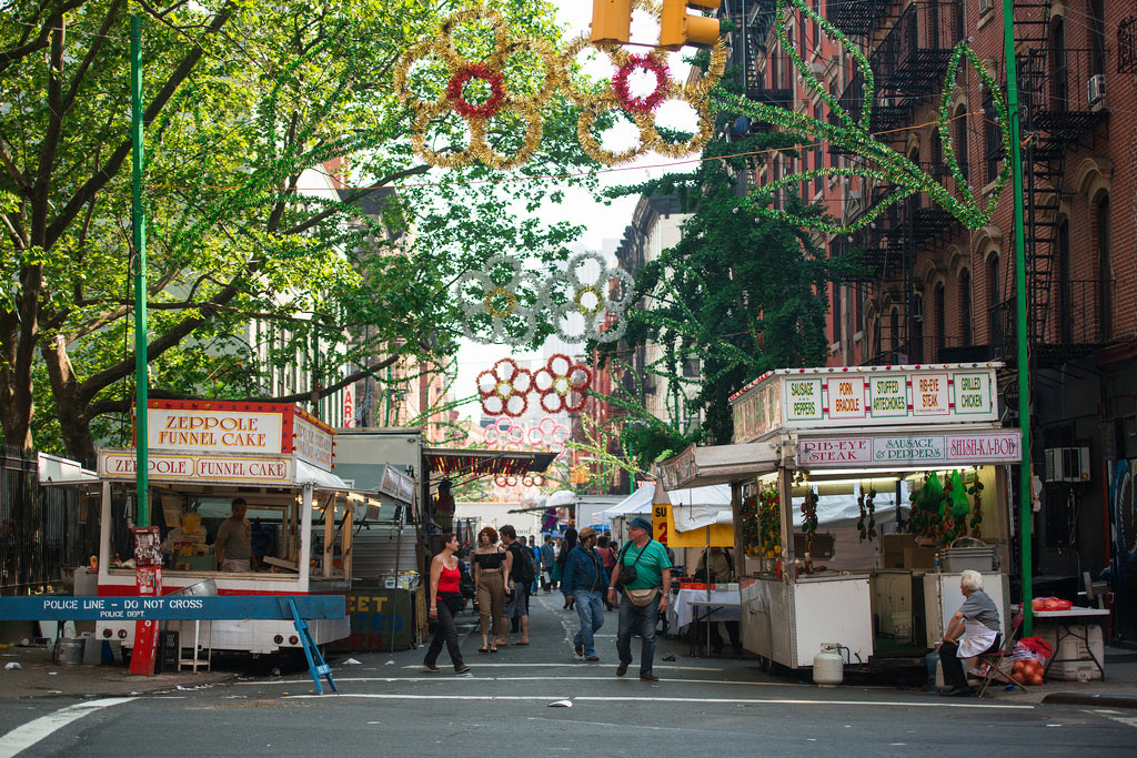 Both Little Italy and Nolita host summer fairs where festival favorites  like funnel cake and corn-on-the-cob are in high demand.