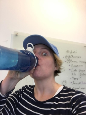 This is what long-distance parenting looks like. I sent that selfie to my daughter to prove to her I was drinking my water...in the middle of thesis.