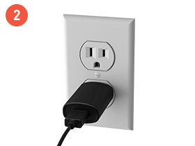 Model Eleven power adapter plugged into an outlet