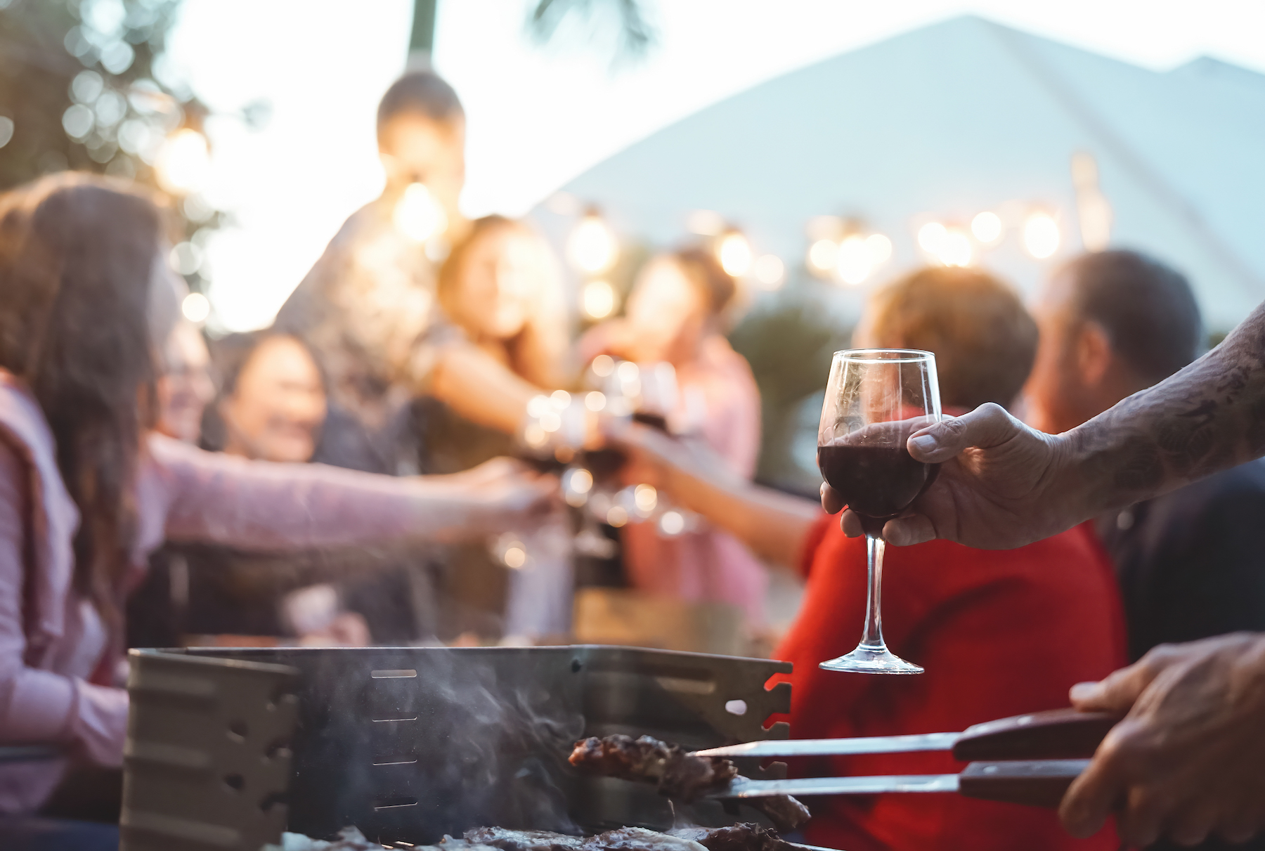Happy-family-doing-celebratory-toast-at-barbecue-party---Young-and-older--parents-having-fun-dining-together-in-garden---Dinner-bbq-food-and-youth-elderly-generation-activities-concept-1189533428 3469x2334