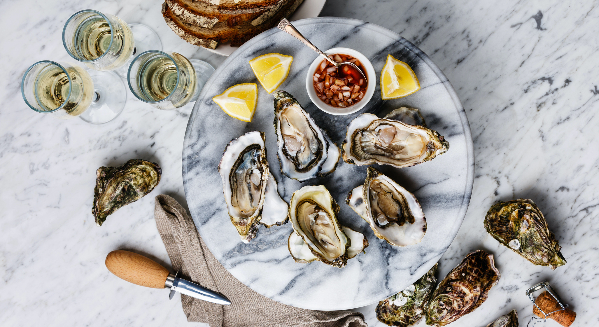 Open-Oysters-with-lemon,-bread,-butter-and-champagne-695621876 1416x2125