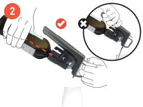 Hands pouring wine with the Coravin Wine Preservation System, with a bubble showing not to hold the System by the Capsule Cup