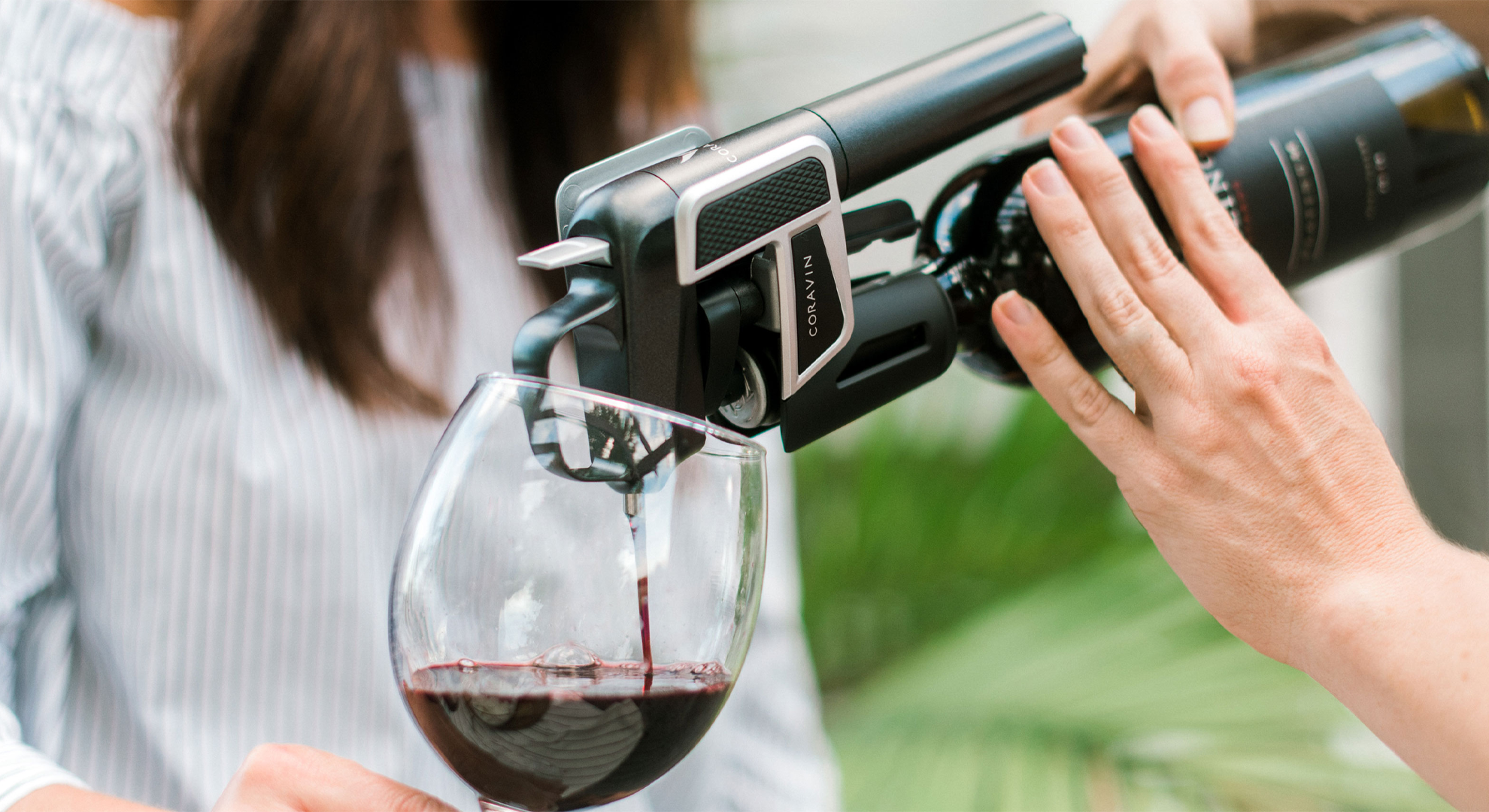 Red wine being poured into a glass using a Coravin Model Two.