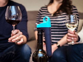 Pivot system on bottle in gray with a group of people socializing with red and white wine in the background.
