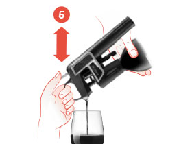 Pour with the Traditional Coravin Wine Preservation System by pressing and releasing the Trigger