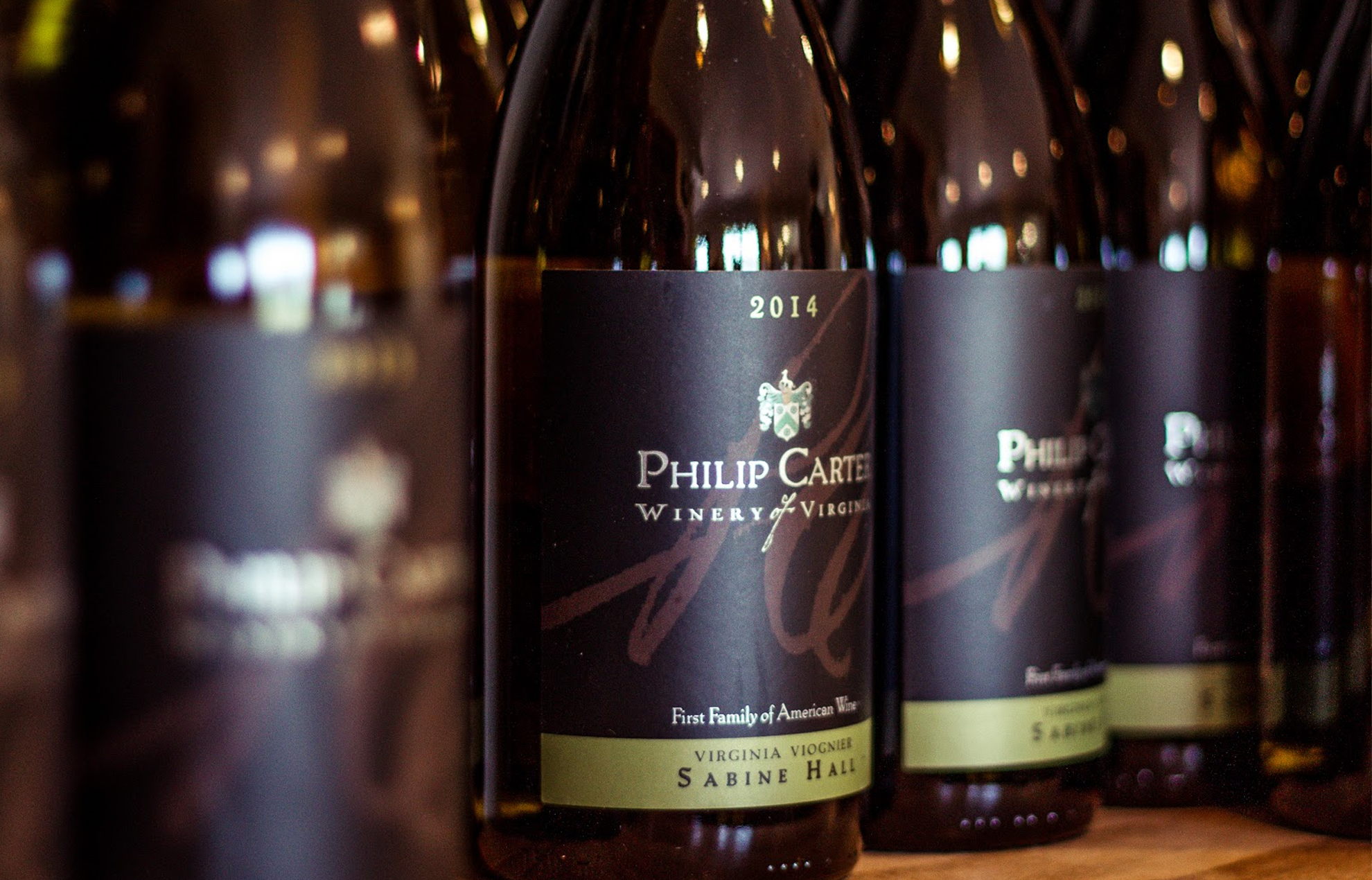 Close up shot of a line of Philip Carter wine bottles.