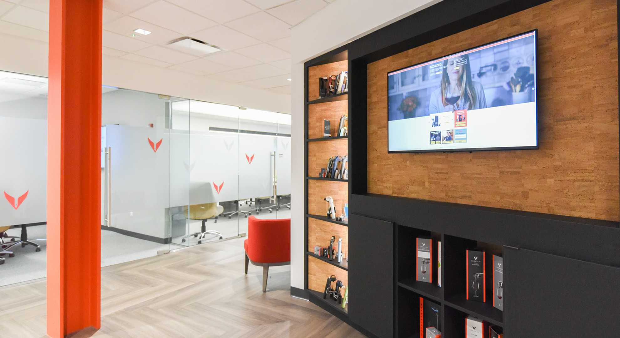 Office entryway setting with boardroom, awards display, and TV, at Coravin Headquarters.