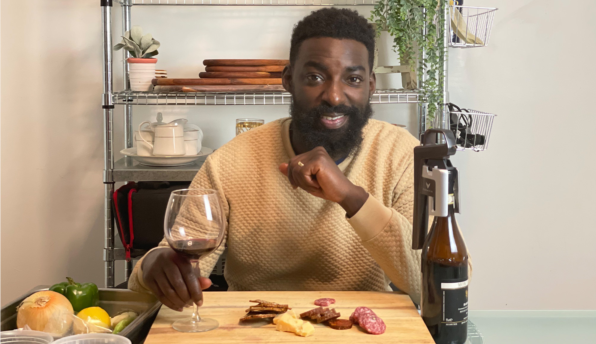 Chef Eric Adjepong with red wine and Coravin