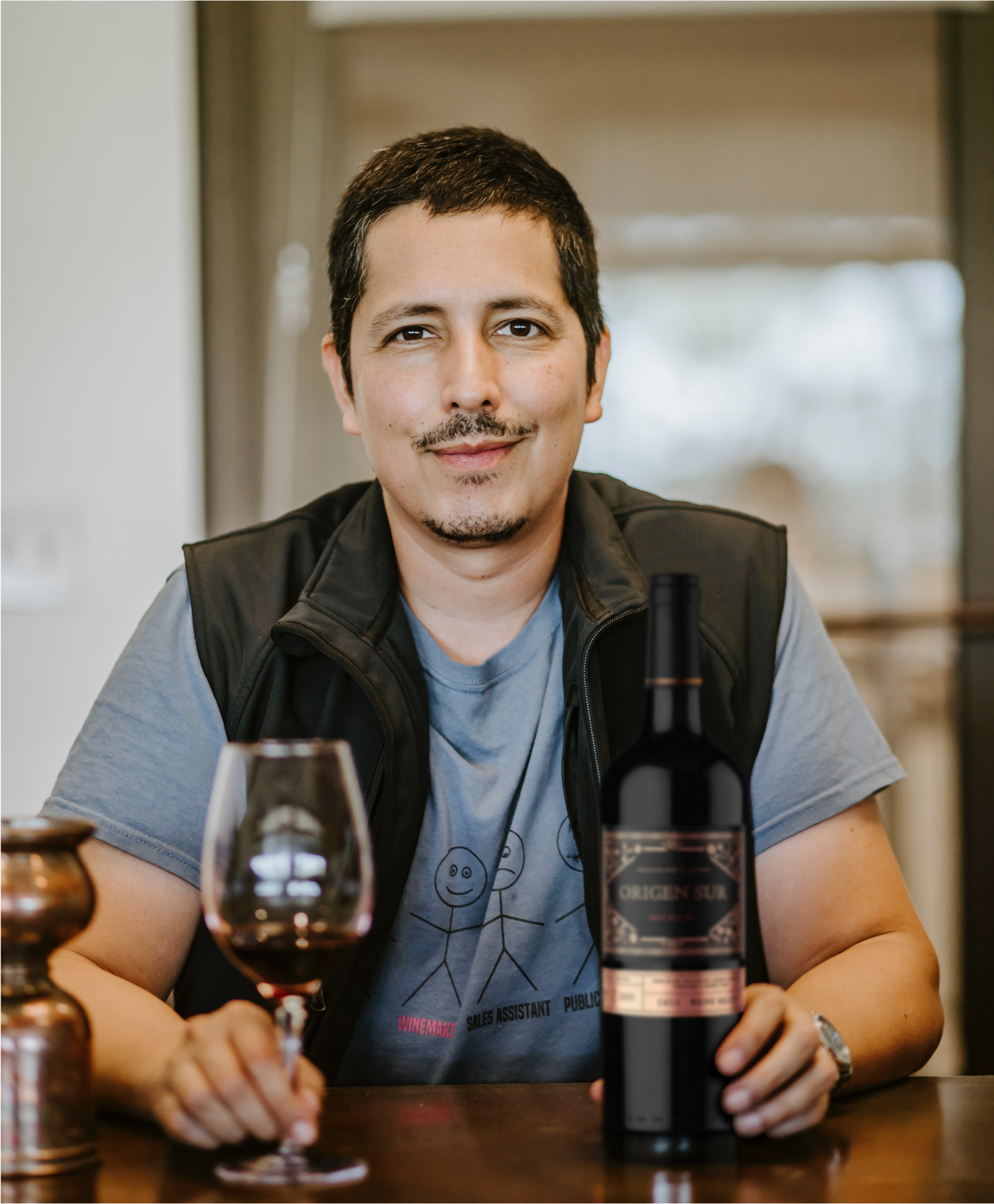 martin reyes with orgin sur wine red
