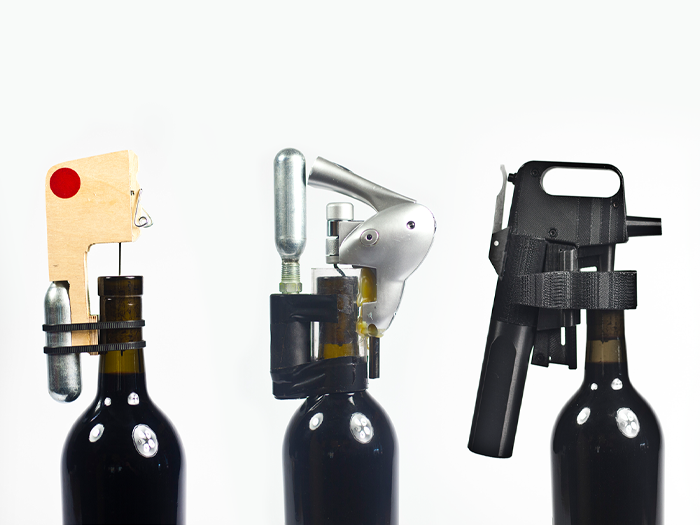Multiple Coravin prototypes on wine bottles.