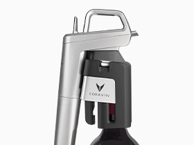 Close up product shot of the Coravin Model Six Wine Preservation System on a wine bottle.