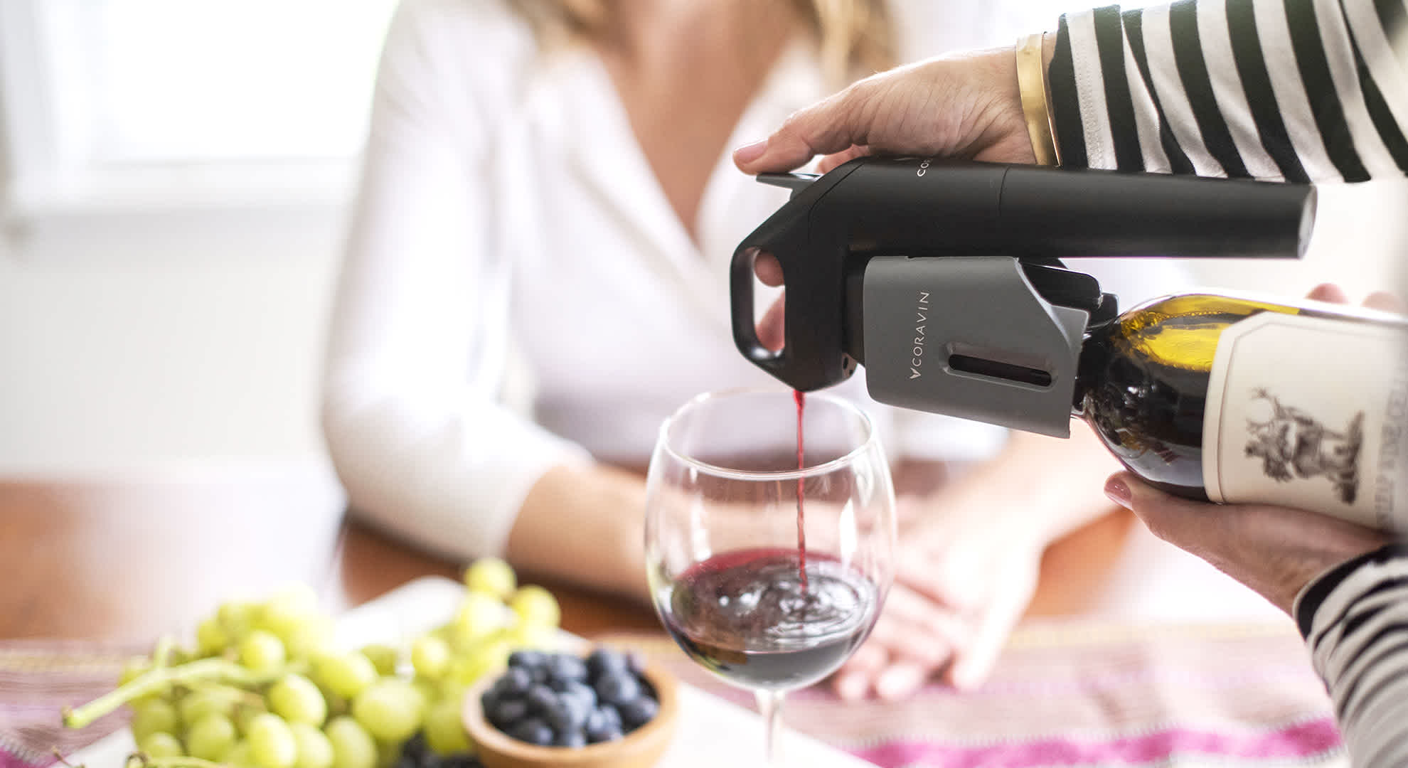 Model Three Wine Preservation System pouring red wine