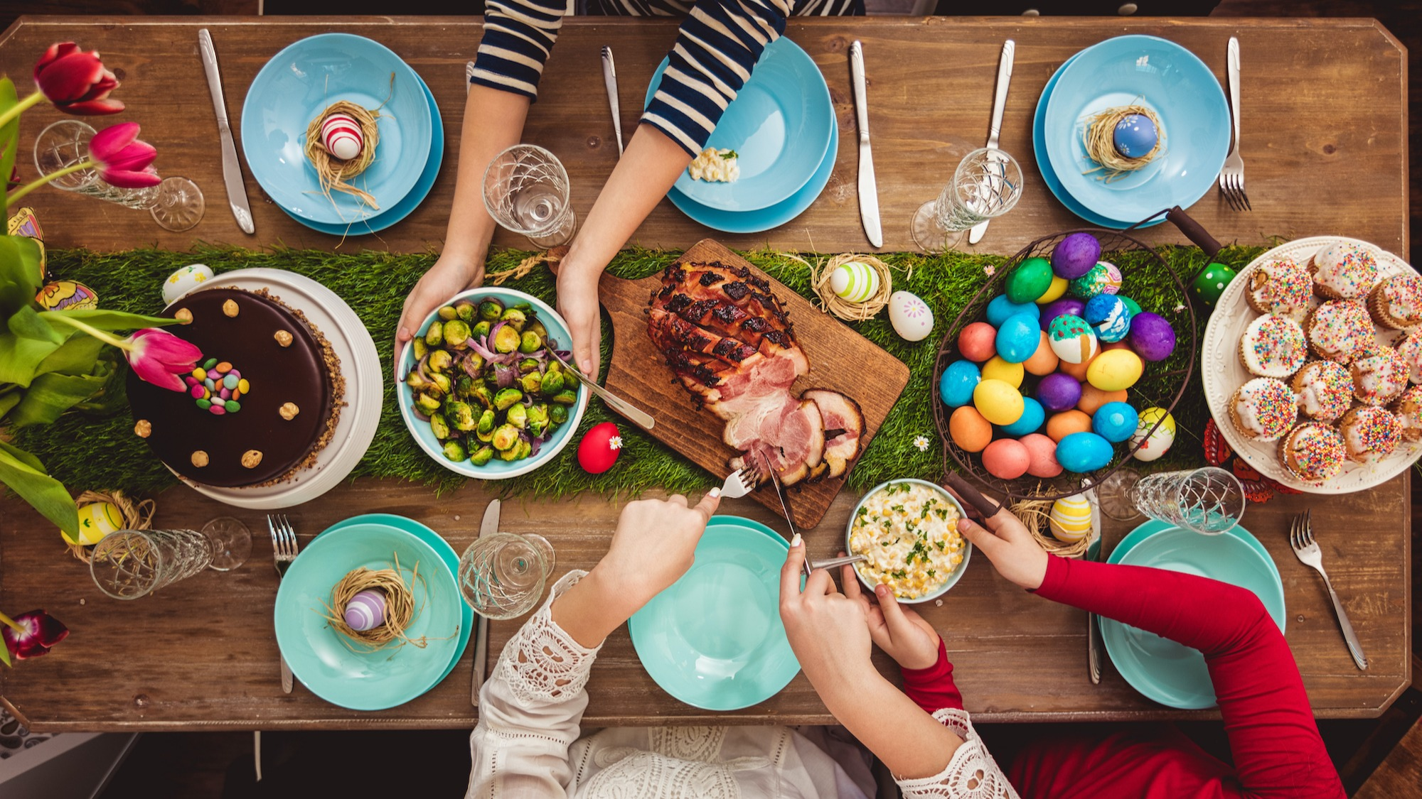easter dinner photo with colored eggs ham and brussel sprouts
