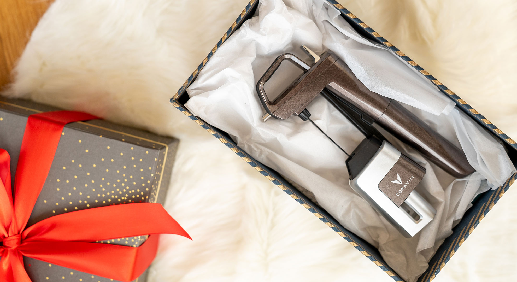 Coravin Limited Edition Mica Wine Preservation System laying in a holiday gift box