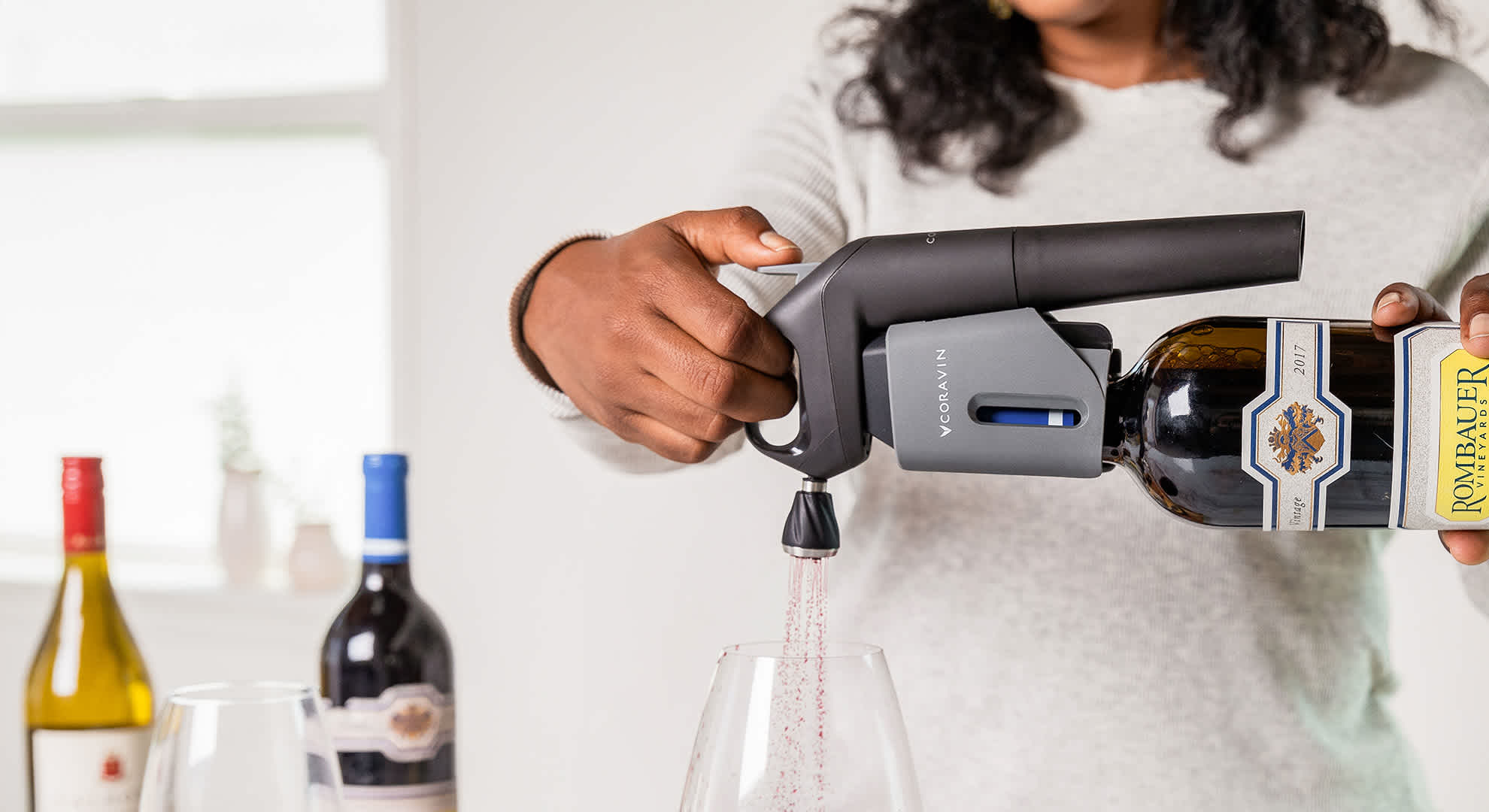 pouring red wine with the Coravin Aerator and Model Three Wine Preservation System