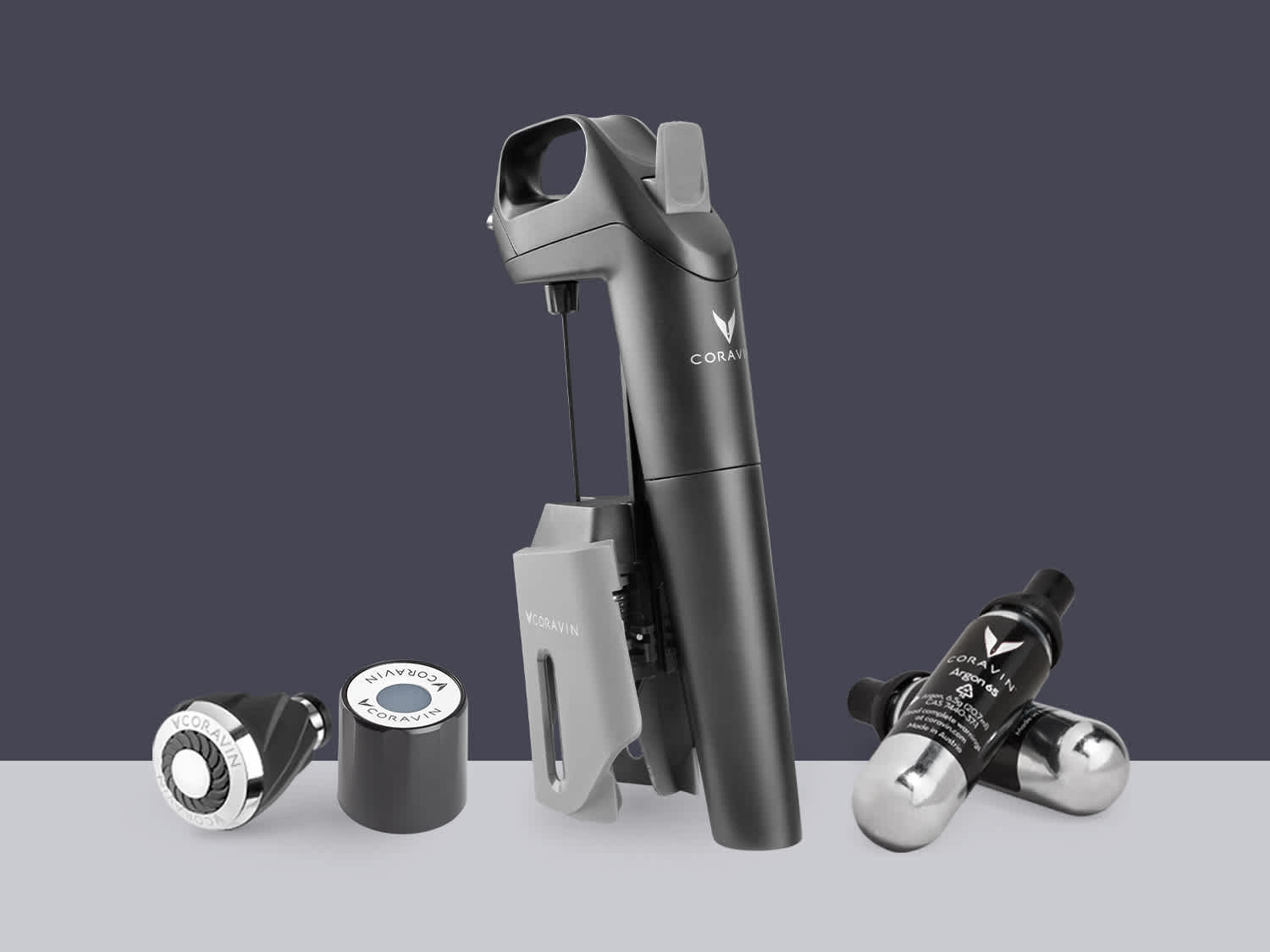 Product shot of Model Three System, two Coravin Capsules, one Coravin Screw Cap, and one Coravin Aerator.
