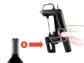 Remove the Traditional Clamps Coravin Wine Preservation System from the bottle by squeezing the clamps open and pulling off horizontally