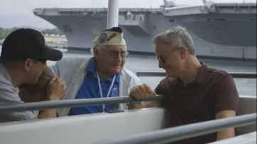 Gary Sinise Takes a Ferry Ride to the Arizona Memorial with Pearl Harbor Survivor Lester Lindow