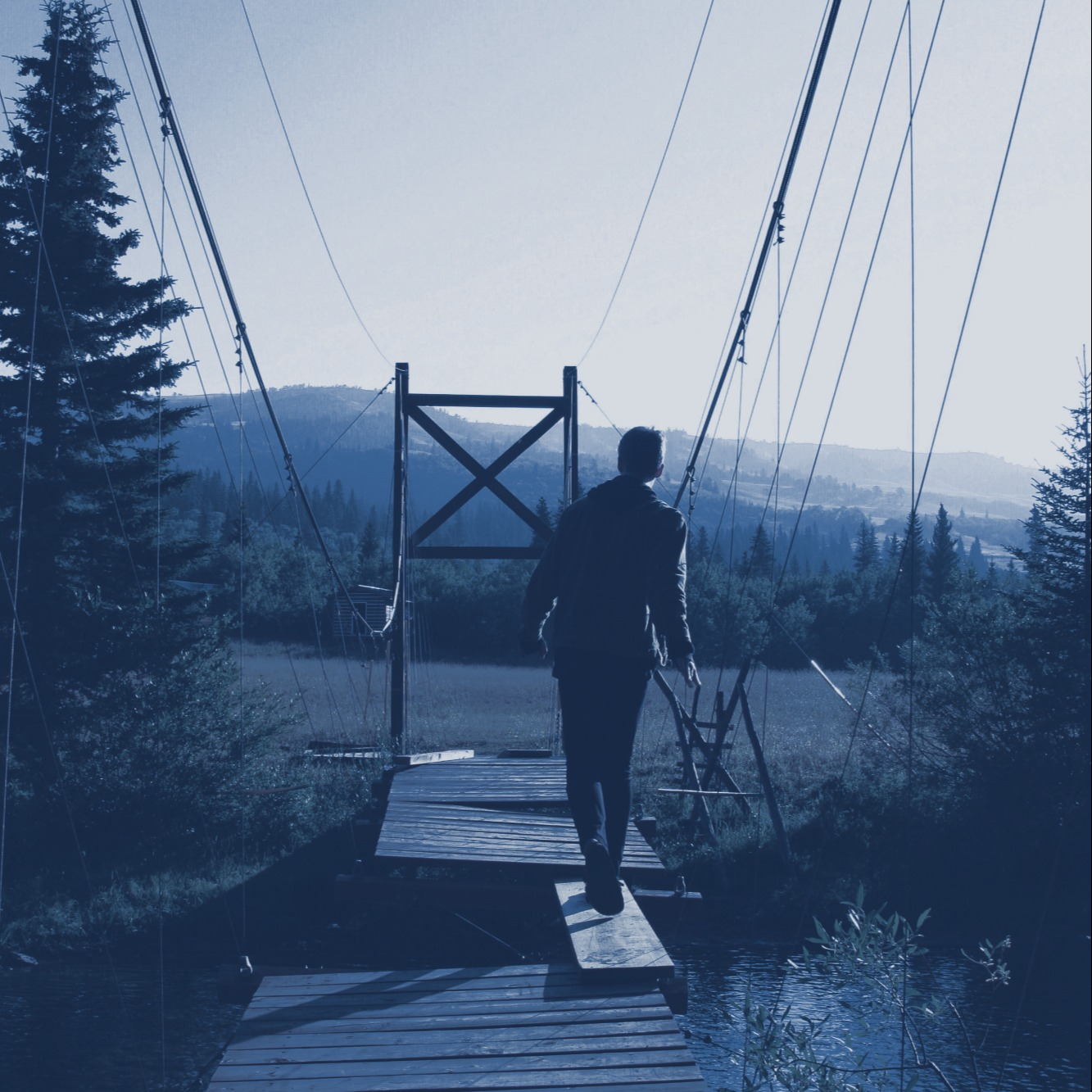 Boy walking on bridge