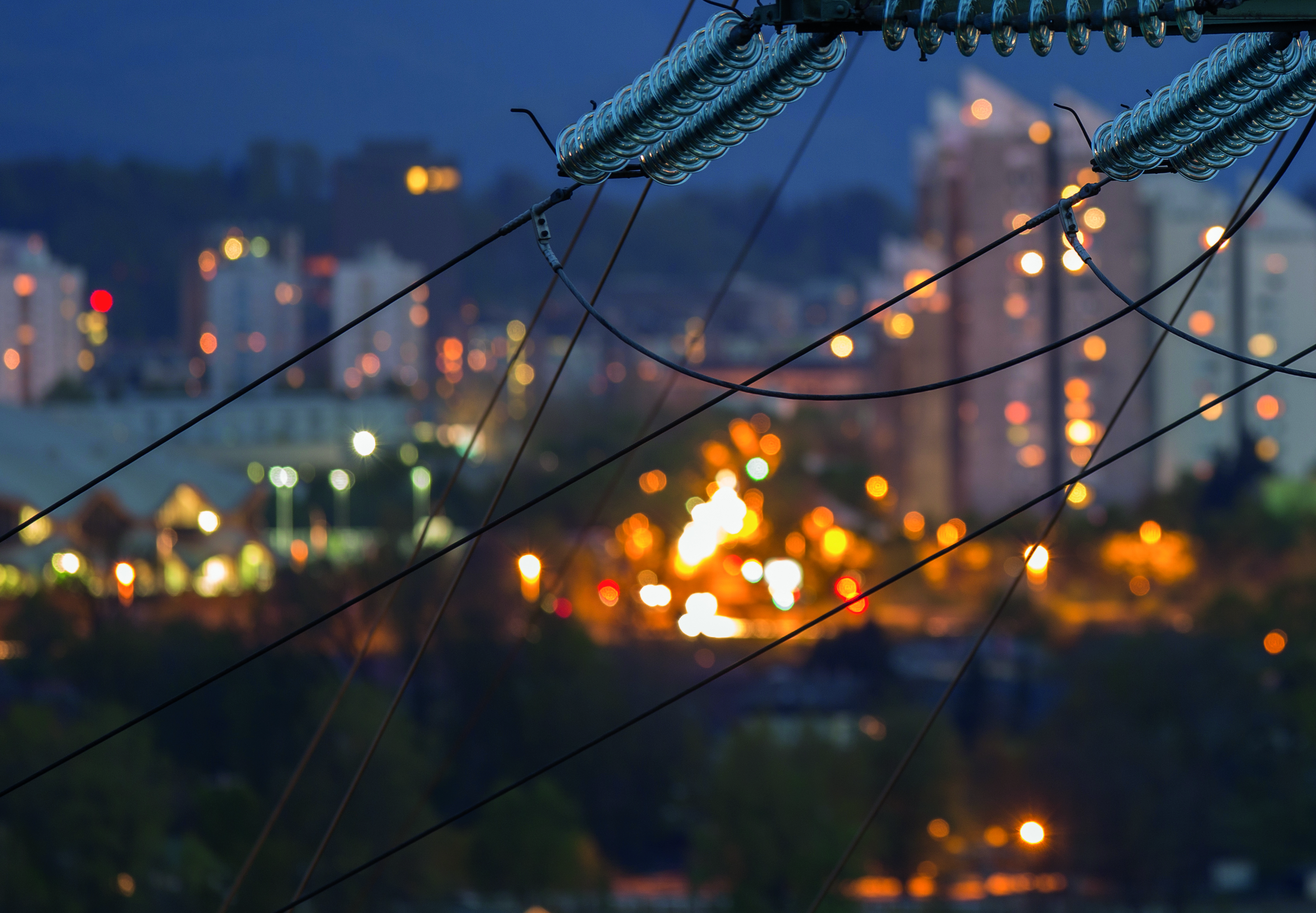 Pylon-and-city-lights.-Electric-infrastructure