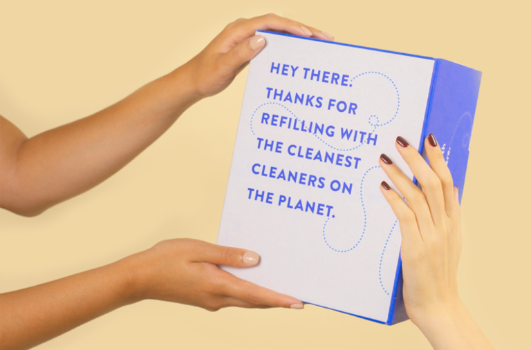 Two hands holding the cleancult refill box