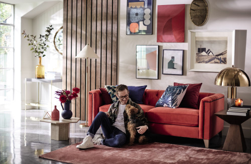 A coral red velvet sofa styled for DFS by Andrew Jonathan Design, interior designer in Bristol, Bath and London.