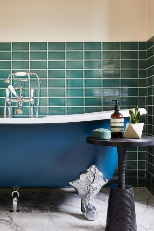 Blue and green bathroom design with roll top bath at a North London loft conversion by Islington interior designer Andrew Jonathan Design