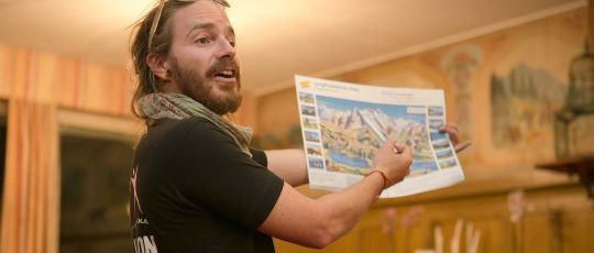 Expat Explore tour leader guide giving directions, summer vacation