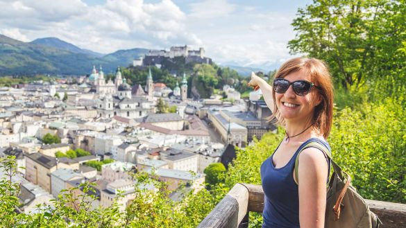 Tourist in Austria, summer vacation to Salzburg, guided tour