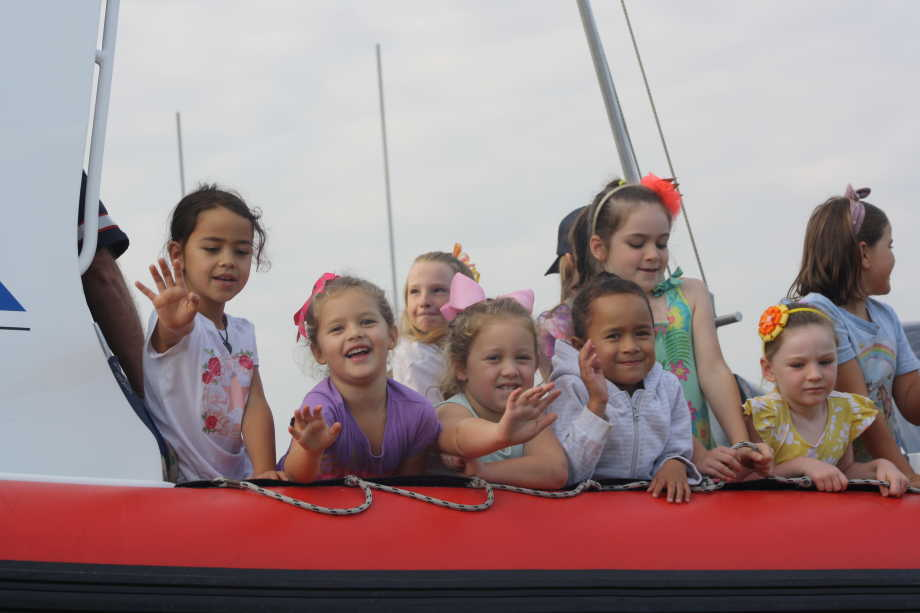 Students from Drury School dressed up on a boat for a day out.