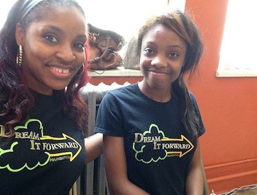 Two women wearing Dream it Forward shirts