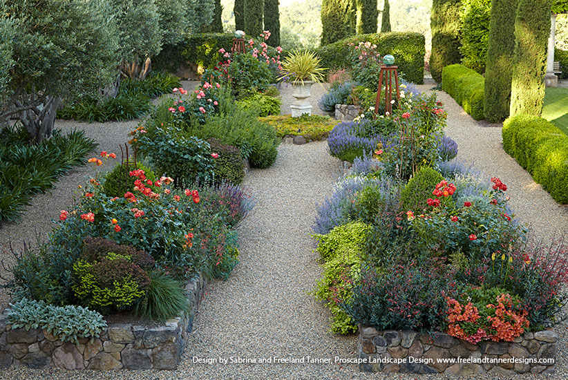 Beautiful stone garden raised beds filled with colorful plants
