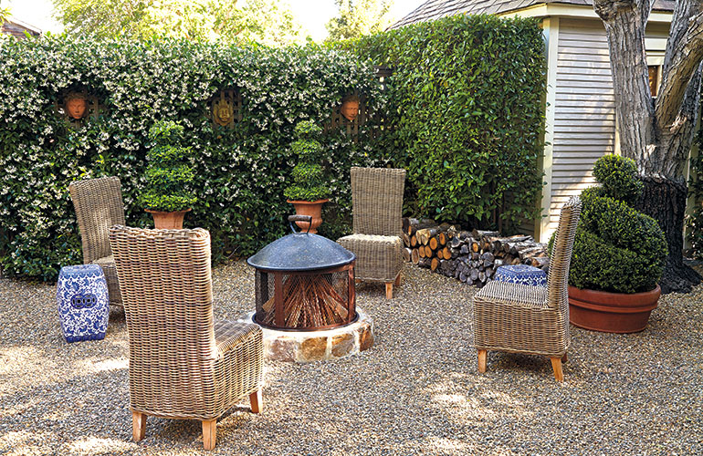 cozy-garden-firepit: Wicker lookalikes, these chairs are actually a manmade material over an aluminum frame so they can stay outdoors all year.