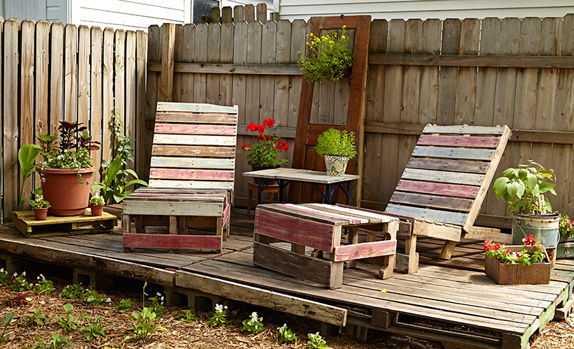 budget-friendly-pallet-furniture-lead: Pallet furniture painted to suit your garden's color scheme is as ornamental as it is comfortable.
